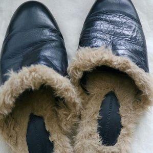Black Zara leather slides.